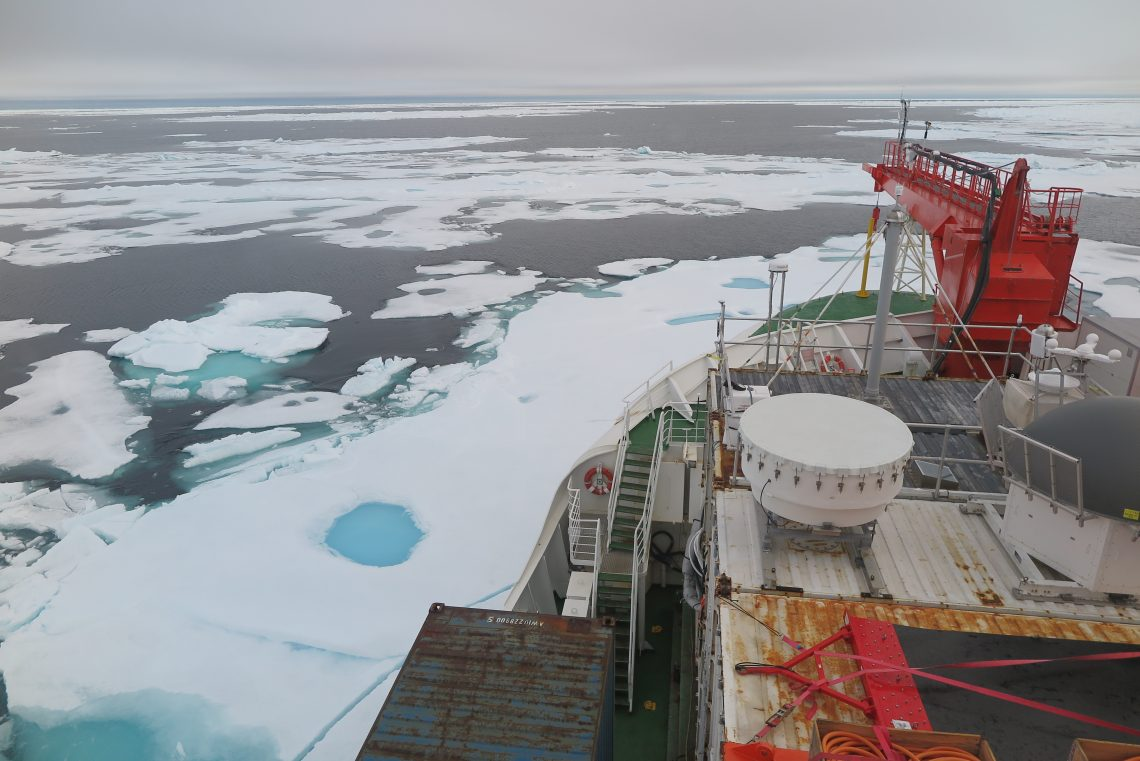 bow of ship with patches of ice and open water