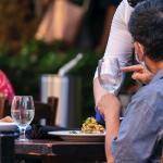Restaurant server at table