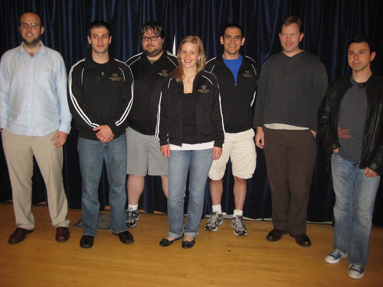 Seven people smiling at the camera