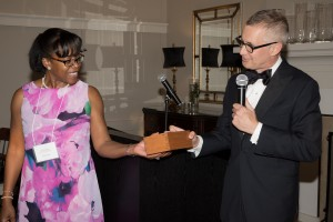Dr. Hunter Wessells presenting Dr. Cheryl Lee with her Bronze Geoduck