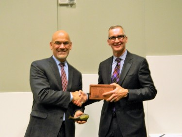 Dr. Rizzo receives the Geoduck from Dr. Wessells