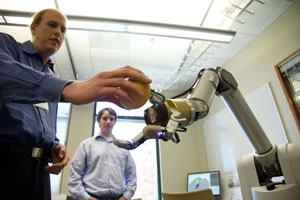 robotic arm and scientists