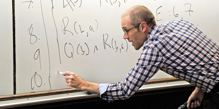 an Schnee writing on whiteboard