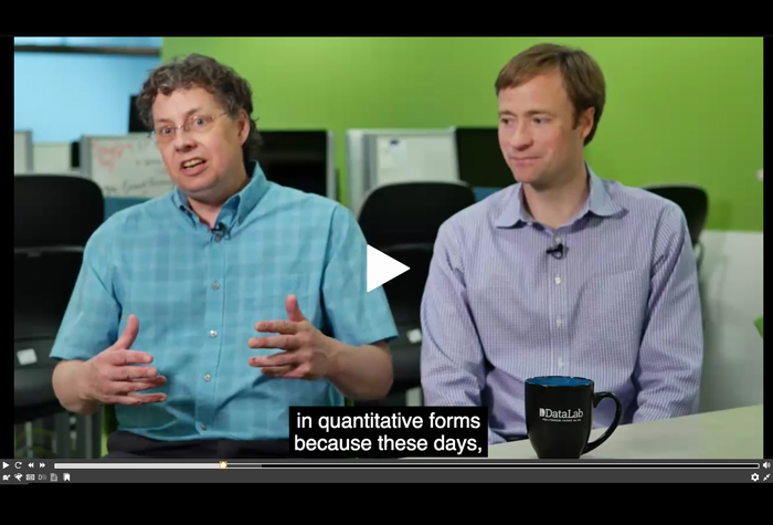 Captioned video of two professors discussing video capturing