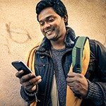 Male student looking at his cell phone