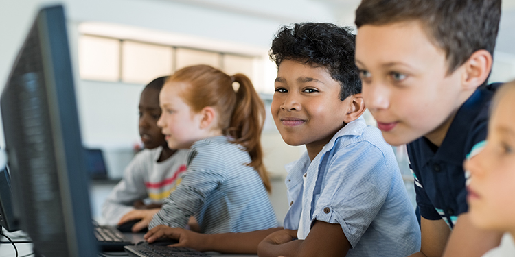 Young children at school working with computers