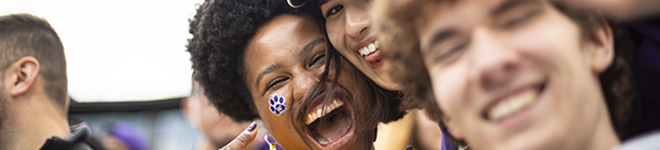 Students and fans cheer at the UW football game vs USC.