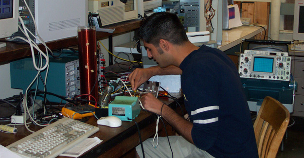 student working on electrical project in lab