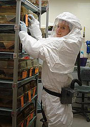 Alevtina Gall working in the lab wearing a haz-mat suit