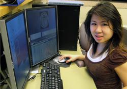 Mindy Szeto working at computer
