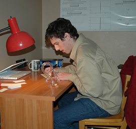 Nate Bottman working at a desk