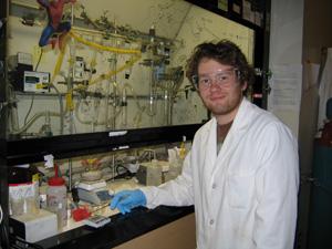 Nicholas Anderson working in fume hood