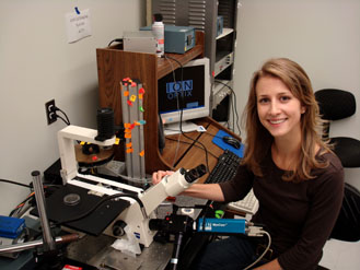 Kate Buckley working with a microscope