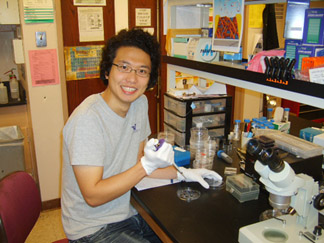Jun Park pipetteing in lab