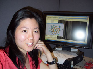 Jane Hung in front of computer screen in lab