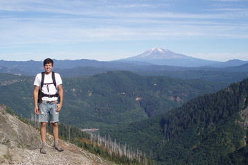 Brent Delbridge hiking with Mt. Rainier in background