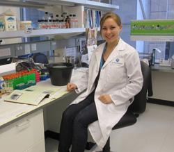 Elizabeth Stanley sitting in lab