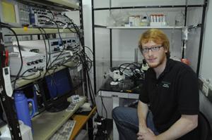 Dan Minter sitting in lab