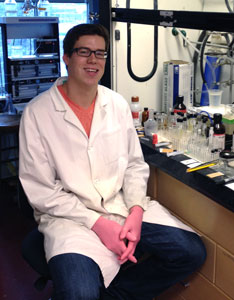 Matthew Sonnett sitting in front of fume hood