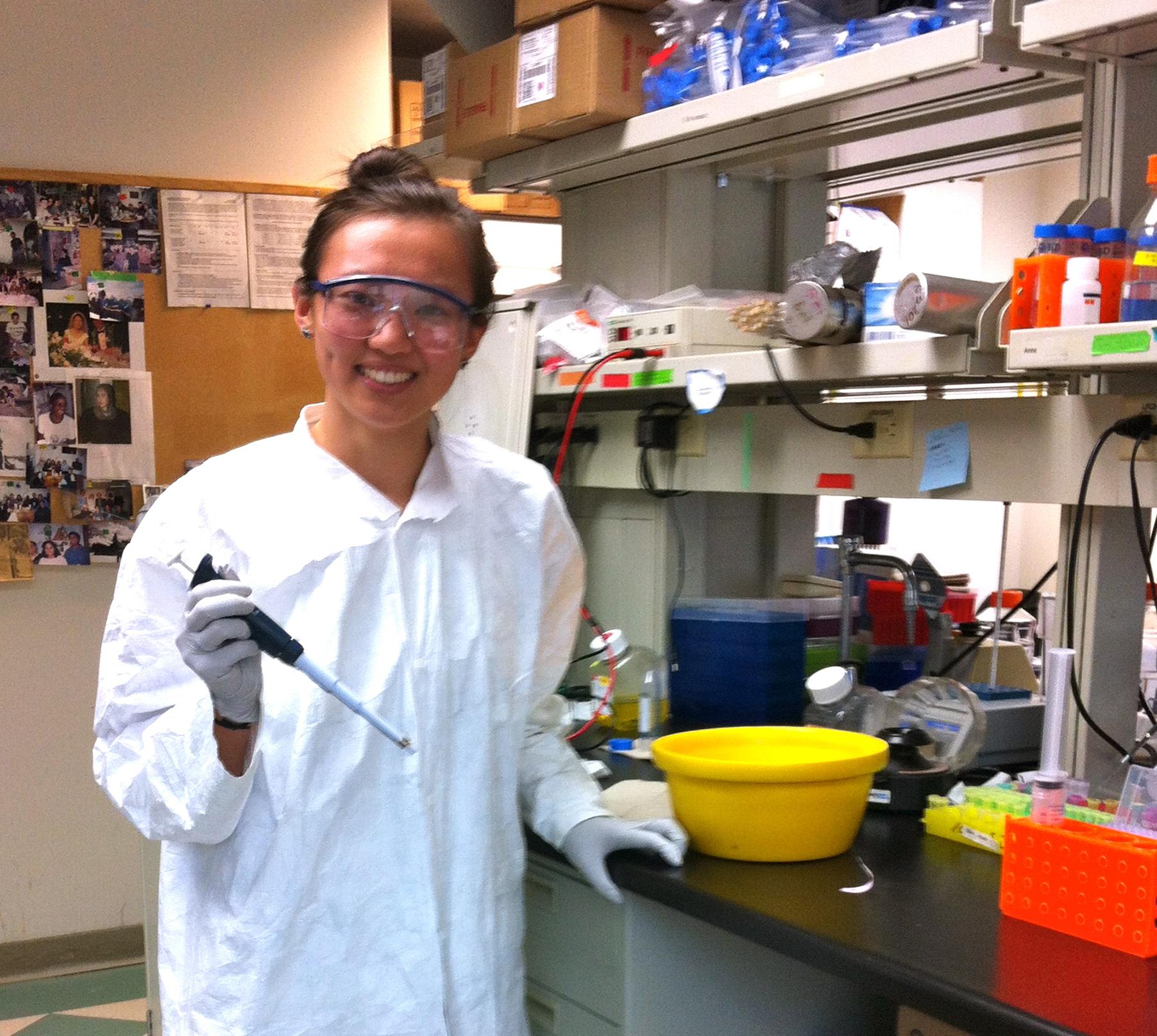 Binjie Wang pipetting in lab