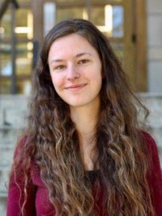 Sara Pemberton Smiling in front of stairs
