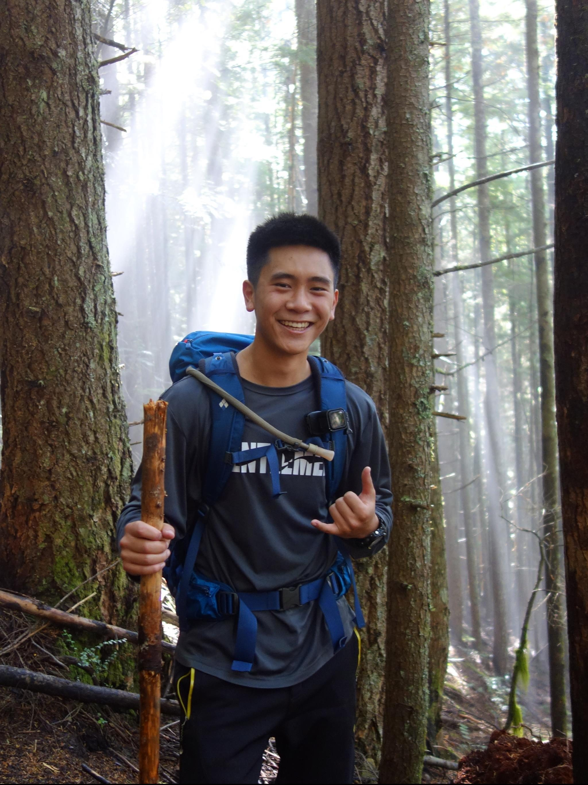 Devin Eng smiling in the forest