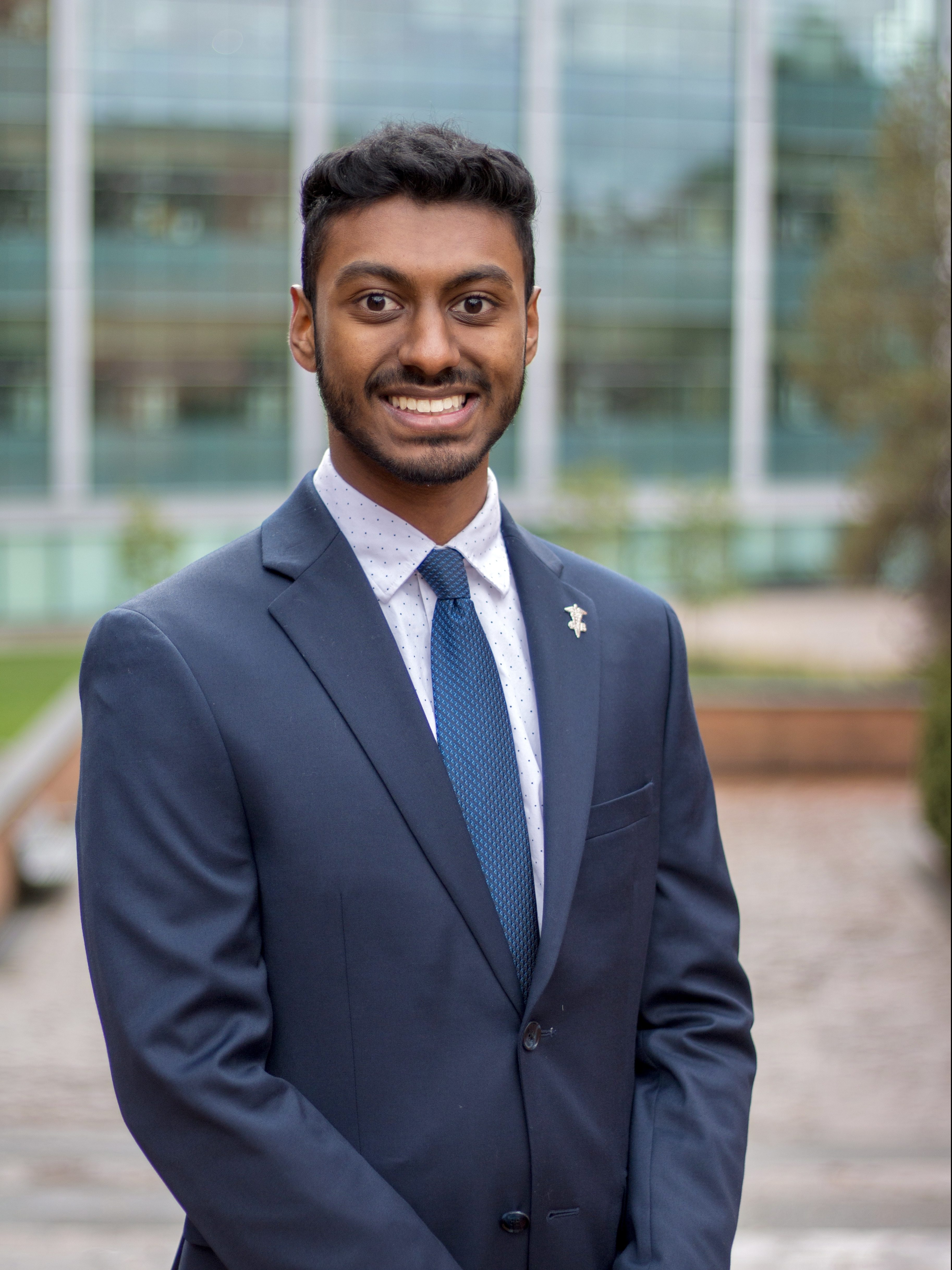 Vasan smiling in a suit