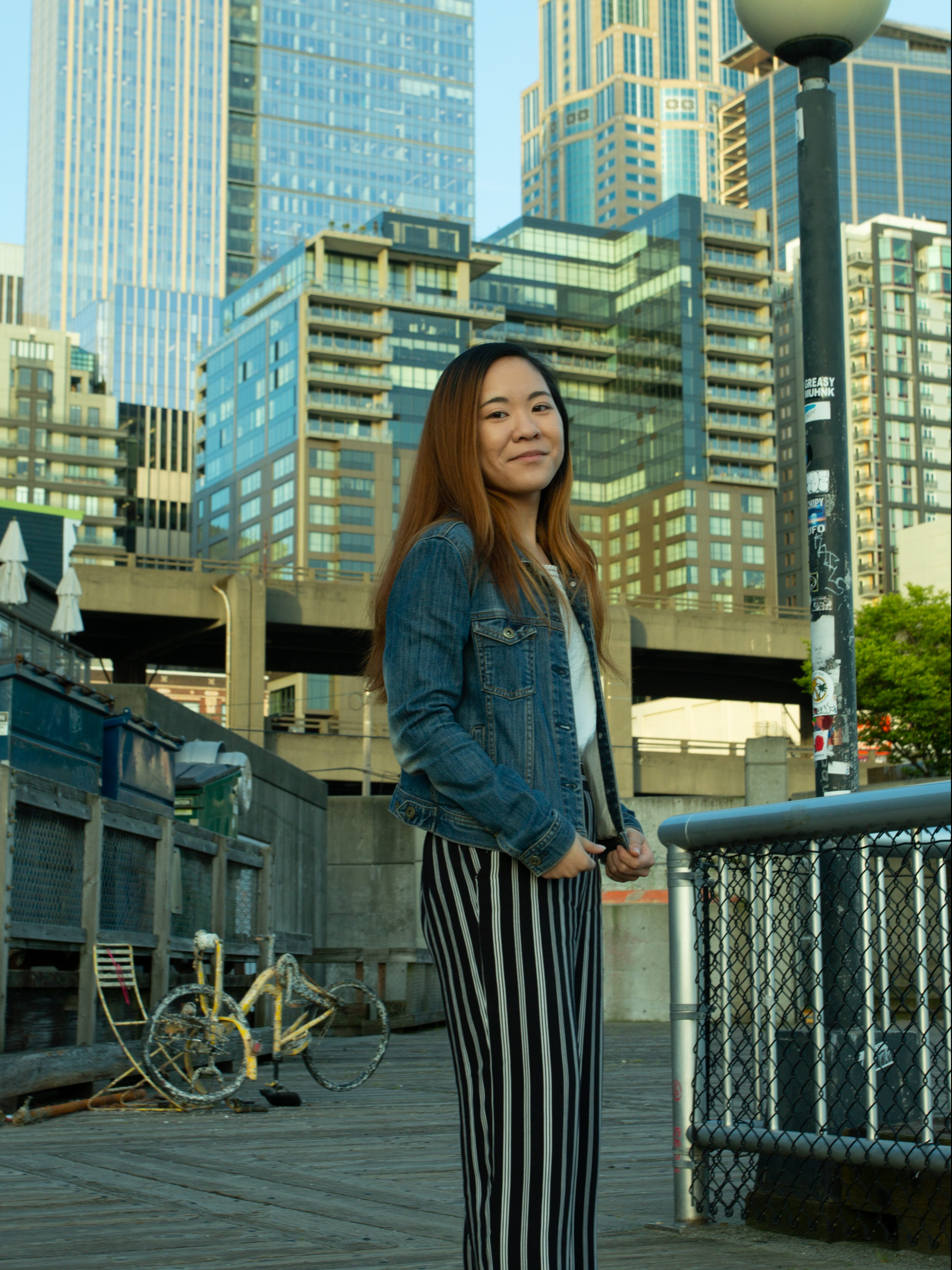 Valerie smiling in front of building