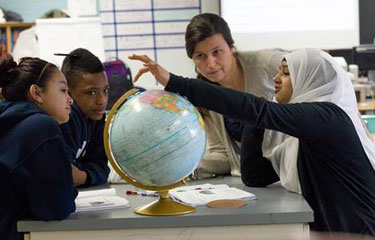 Students studying a globe