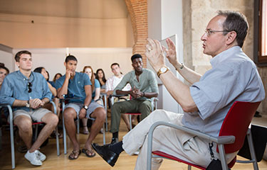 Professor addressing a group of students