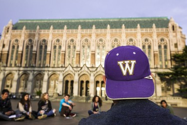 back view of man wearing purple W cap