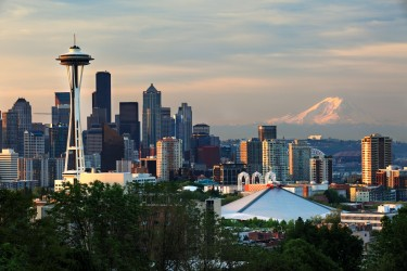 View of downtown Seattle, Space Needle, and Mt. Rainier at sunset