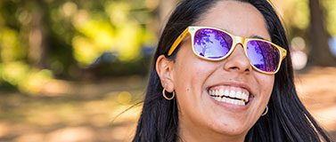 UW student wearing purple and gold sunglasses