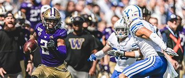 Aaron Fuller runs with the ball against a BYU defender