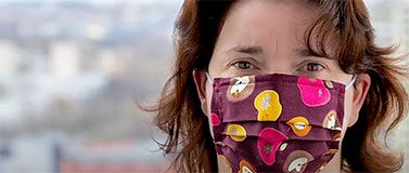 Hillary Godwin, dean of the UW School of Public Health, wears a facemask
