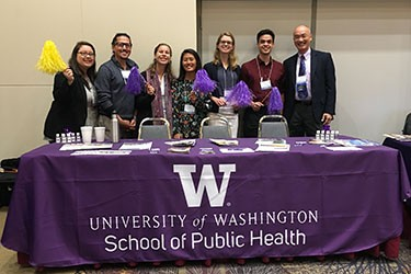 School of Public Health employees table with UW swag