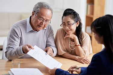 Older couple looking at document