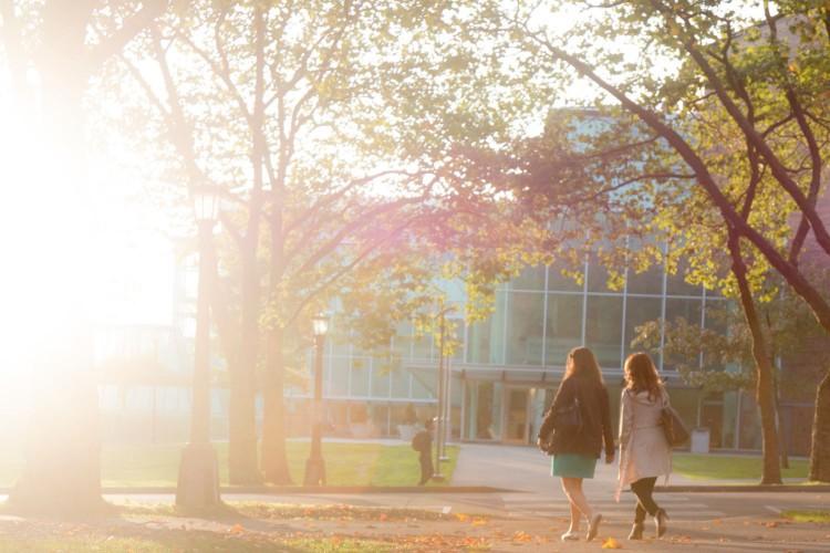 Image of women walking outside of Gates Law School