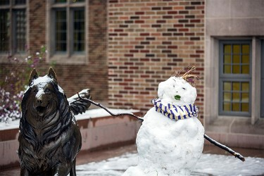 Image of snowman next to the Husky statue