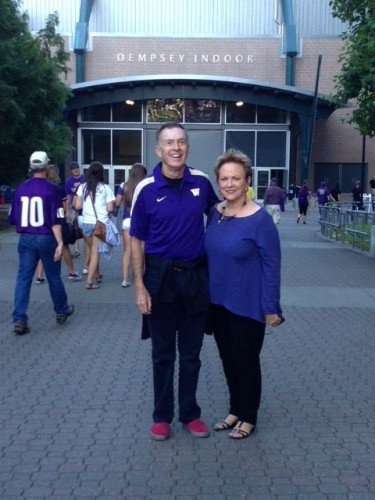 Neal and Jan share a moment in front of the Dempsey Indoor Practice Facility.