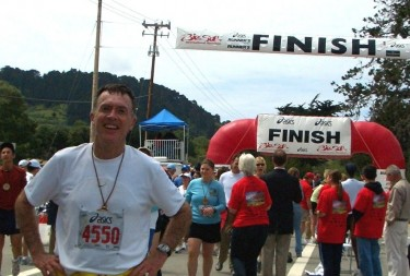 Neal is all smiles after finishing yet another marathon.