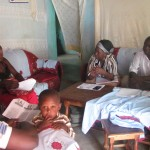 Health workers conduct an HIV testing and counseling session in the home of a study participant and her male partner.