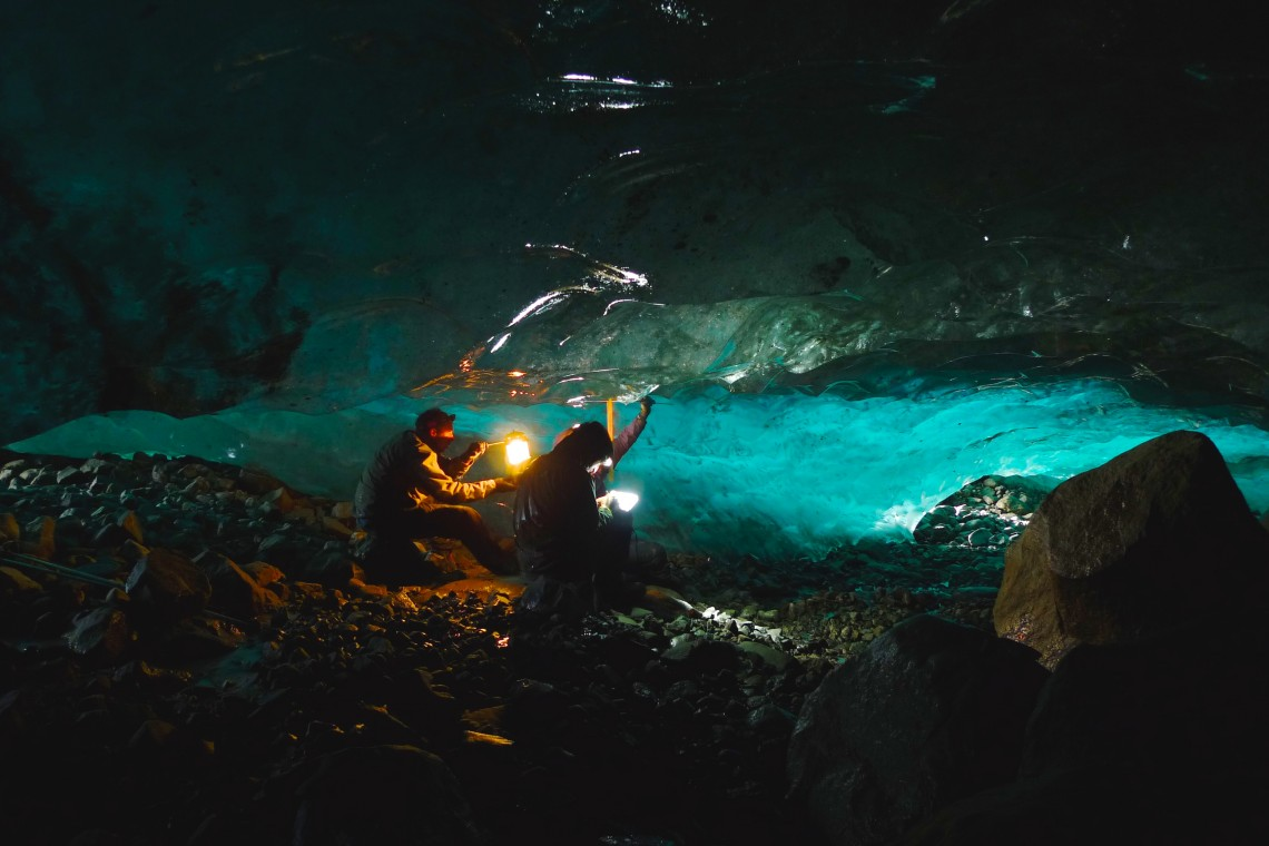 Students measure scallops in the ice under the Llewellyn Glacier on the Juneau Icefield. Markle, there as a guide and teacher, also served as an impromptu photographer. There is a very active river network under — and inside — many glaciers, and the cave completely flooded a day later.