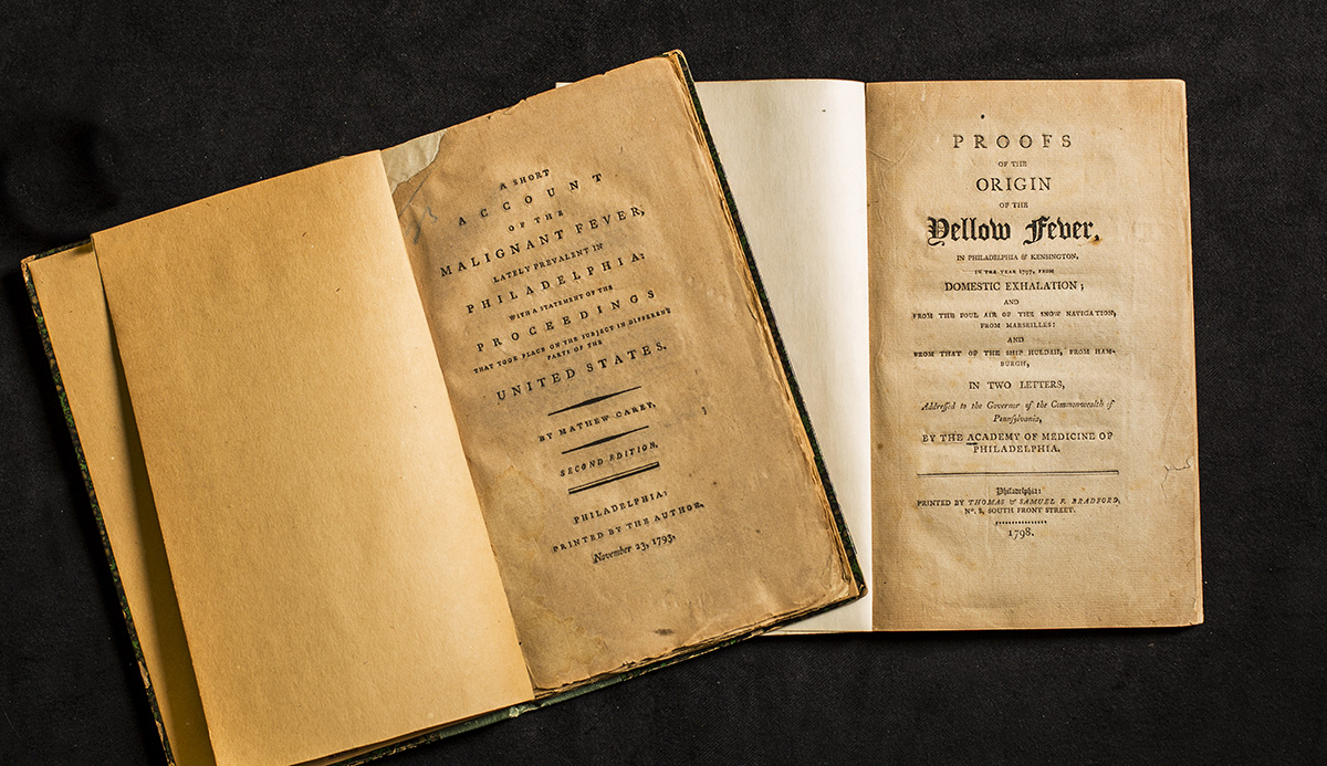 "In the early 18th and 19th centuries, advancements in medicine came quickly, resulting in medical books printing new editions every few years. The book on the left, published in 1793, is about ""malignant fever;"" on the right is the next edition of the book, published just five years later, featuring the name for malignant fever used today: yellow fever."