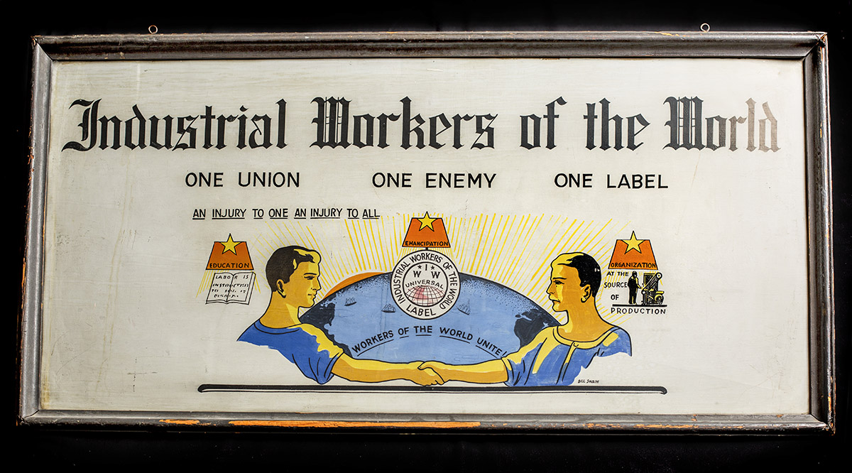 "A sign from the Seattle Industrial Workers of the World's Seattle office. IWW members were known as the ""Wobblies."" In 1916, several Wobblies were killed in an altercation with Everett, Washington, police and citizen vigilantes, an event remembered as the Everett Massacre."