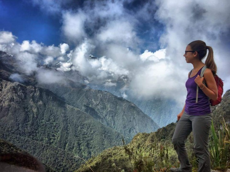 UW graduate Sheri Imsdahl on a ridge overlooking a valley.