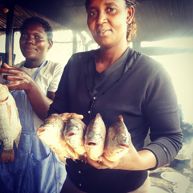 """Markets always seem to hold the heartbeat of a city,"" says Imsdahl, who visited as many as she could. She snapped this photo at a fish market on the shore of Kenya's Lake Naivasha."