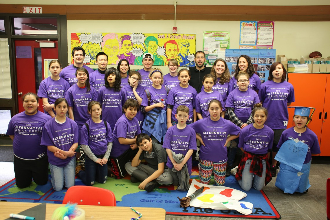 Neah Bay fifth-graders smile for the camera with their UW mentors and teacher Seth Vanzant.