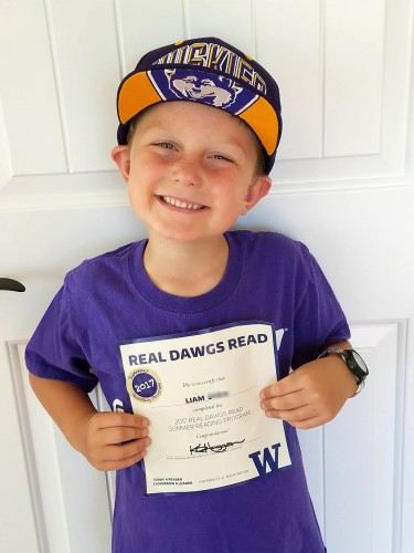 Real Dawgs Read participant shows a certificate of completion.