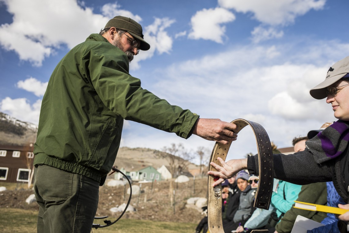 Rick Wallen, lead biologist for bison in Yellowstone, shares with students a collar used to monitor bison in the park.